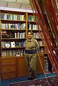 Iraq 2014  Koysinjak, Nahid Hosseini,poet, journalist, activist at home in her library <br />Irak 2014 Dans sa maison de <br />Koysinjak, Nahid Hosseini, poetesse, journaliste, activiste devant sa bibliotheque