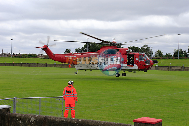 Irish Coast Guard Rescue 116 landing in the O'Raghallaighs GAA Grounds in Drogheda Beside Our Lady of Lourdes Hospital, Carrying a female diver casualty from Skerries, It is believed that the diver was recovered on the beach after a distress call and a search involving Skerries RNLI, Skerries Coast Guard and Rescue 116, a number of shore divers got swept away in the current, the female casualty was recovered in a critical condition suffering from severe Hypothermia and jelly fish sting to the face. Drogheda Coast Guard assisted int eh transfer of the casualty from rescue 116 to the awaiting ambulance.<br /> Picture Fran Caffrey www.newsfile.ie