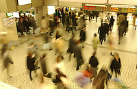 People rush through one of many ticket halls in Shinjuku station in Tokyo, during rush hour. The station, the busiest in the world, has an estimated two million people passing through on a daily basis.<br />Mar 2002