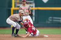 Virginia Cavaliers second baseman Ernie Clement (4) tags out Arkansas Razorbacks baserunner Brett McAfee (5) in Game 1 of the NCAA College World Series on June 13, 2015 at TD Ameritrade Park in Omaha, Nebraska. Virginia defeated Arkansas 5-3. (Andrew Woolley/Four Seam Images)