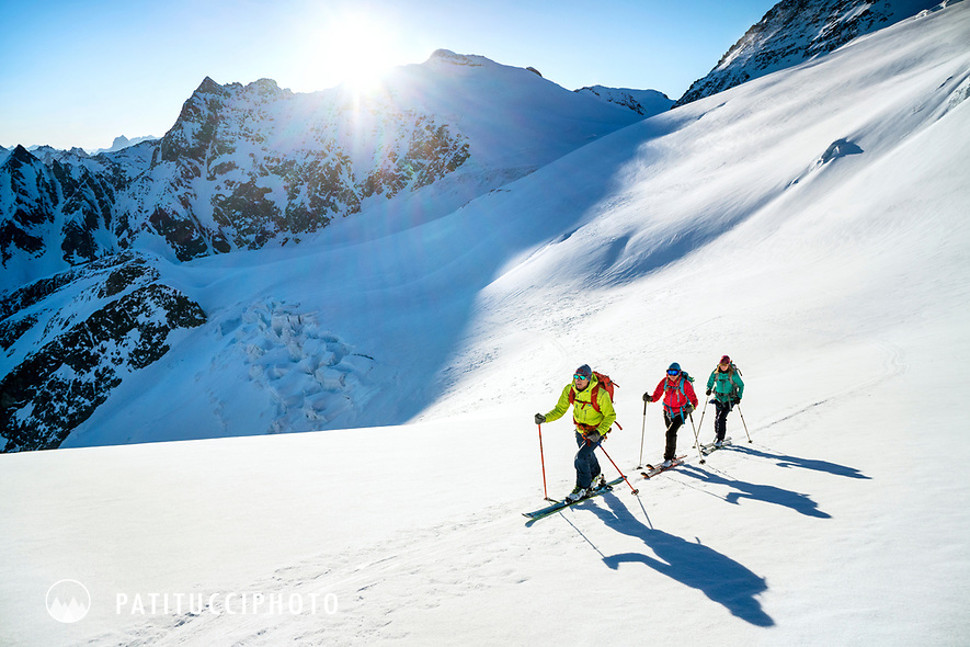 Ski touring on the Berner Haute Route, Switzerland, a group of skiers on day two leaving the Tierbergli Hut for the Trift Hut
