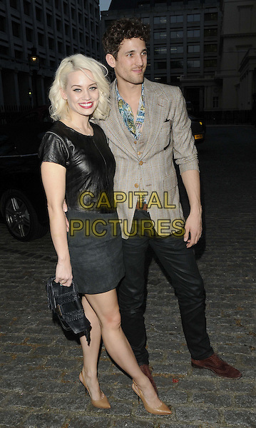 Kimberly Wyatt & Max Rogers.The Molton Brown & Giles Deacon launch party & 40th anniversary event, The ICA, Carlton House, The Mall, London, England..April 17th, 2013.full length black dress leather top skirt clutch bag trousers beige suit jacket couple side .CAP/CAN.©Can Nguyen/Capital Pictures.