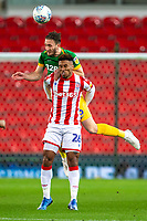 12th February 2020; Bet365 Stadium, Stoke, Staffordshire, England; English Championship Football, Stoke City versus Preston North End; Ben Davies of Preston North End heads the ball over Tyrese Campbell of Stoke City - Strictly Editorial Use Only. No use with unauthorized audio, video, data, fixture lists, club/league logos or 'live' services. Online in-match use limited to 120 images, no video emulation. No use in betting, games or single club/league/player publications