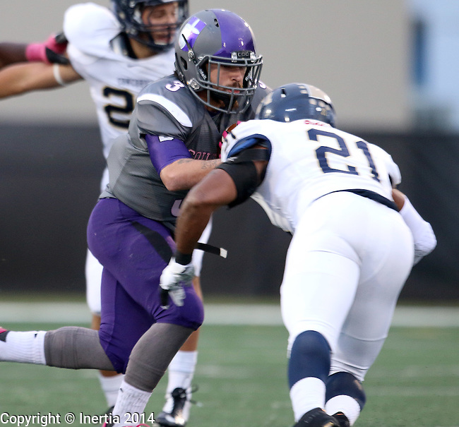SIOUX FALLS, SD - OCTOBER 4: Nephi Garcia #3 from the University of Sioux Falls looks to shake the grasp of Abdullah Asad #21 from Concordia St. Paul in the first half of their game Saturday evening at Bob Young Field.(Photo by Dave Eggen/Inertia)