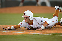 Texas Longhorn outfielder Mark Payton #15 dives back to first base against the Arizona State Sun Devils  in NCAA Tournament Super Regional Game #3 on June 12, 2011 at Disch Falk Field in Austin, Texas. (Photo by Andrew Woolley / Four Seam Images)