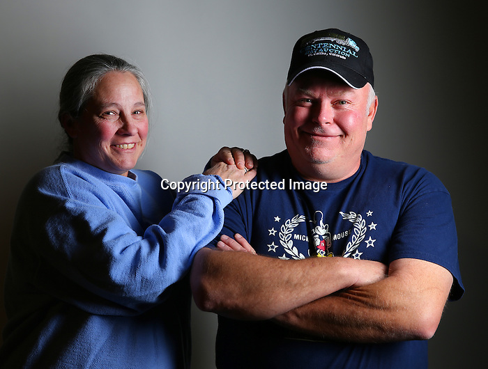 "Pam Babcock and her husband Larry Milbourn laugh during a portrait session at the Hynds Building on New Year's Eve. Milbourne said the small town feel of Cheyenne makes it a great place to raise he and Pam's 2 daughters. 'We love it. We are close to the mountains and we like hunting and fishing.' Said Milbourne. To participate in WTE Photo Editor Michael Smith's ""Our Faces: Portraits of Laramie County"" project, call 633-3124 or 630-8388 or email msmith@wyomingnews.com to make an appointment. To see all of the portraits published so far, go online to ourfaces.wyomingnews.com. Michael Smith/staff"