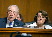 United States Senator Charles Grassley (Republican of Iowa), Chairman, US Senate Committee on the Judiciary, left and US Senator Dianne Feinstein (Democrat of California), Ranking Member, US Senate Committee on the Judiciary, right, listen as Christopher A. Wray testifies on his nomination to be Director of the Federal Bureau of Investigation (FBI) before the committee on Capitol Hill in Washington, DC on Wednesday, July 12, 2017.<br /> Credit: Ron Sachs / CNP<br /> (RESTRICTION: NO New York or New Jersey Newspapers or newspapers within a 75 mile radius of New York City)