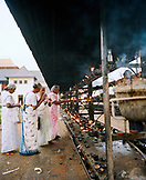 SRI LANKA, Asia, Kandy, senior women praying in the temple of the tooth