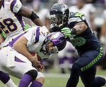 Minnesota Vikings quarterback Christian Ponder is sacked by Seattle Seahawks linebacker Leroy Hill at CenturyLink Field in Seattle, Washington on  November 4, 2012.  Ponder completed 11 of 22 passes for 64 yards, was sacked four times and  had one pass intercepted in the Vikings 20-30 loss to the Seahawks.