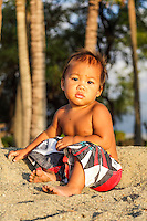 A Hawaiian child pauses while playing at 'Anaeho'omalu Beach near 'Anaeho'omalu Bay (or A-bay) in Waikoloa on the Big Island of Hawai'i.