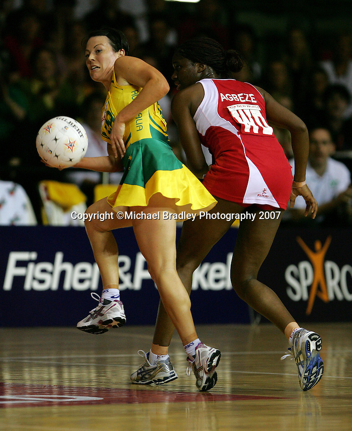 16.11.2007 Australian Laura von Bertouch and England's Ama Agbeze in action during the Australia v England match at the New World Netball World Champs held at Trusts Stadium Auckland New Zealand. Mandatory Photo Credit ©Michael Bradley.
