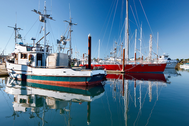 Boats in Brookings Harbor with reflection. Oregon