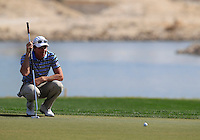Brett Rumford (AUS) lines up his putt on the par3 13th green during Friday's Round 3 of the Commercial Bank Qatar Masters 2013 at Doha Golf Club, Doha, Qatar 25th January 2013 .Photo Eoin Clarke/www.golffile.ie