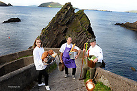Pictured at the launch of 'The Dingle Food Festival' at Dun Caoin Pier were Dingle hospitality representatives Carol Ryan, Mark Murphy and Trevis Gleson. The festival takes place this October from the 2nd-4th.<br /> Photo by Sally MacMonagle.<br /> <br />   PR PIC<br /> <br /> ALL ABOARD FOR THE 2015 DINGLE FOOD FESTIVAL!<br /> Visuals provided by MacMonagle on 064 6632833<br /> <br /> Tuesday 1st September 2015.  Dingle Town has just announced details of its 9th annual Food Festival (2 &ndash; 4 October); the fastest growing food festival in the country.  This year over 10,000 visitors from home and abroad are expected to flock to Dingle to seek out the wonderful culinary delights, great value entertainment, unique atmosphere and spectacular scenery that this destination has to offer.<br /> <br /> This event will be the icing on the cake of a bumper summer season in Dingle, which, according to the Dingle Chambers of Commerce  has seen a double digit increase in turnover by local businesses in comparison to 2014.<br /> <br /> Over the weekend local and national celebrity, award-winning chefs such as Martin Bealin (Global Village), Mark Murphy (Dingle Cookery School), Jean Marie Varieux (Out of the Blue) Neven Maguire and Mark Moriarty will deliver a tasty programme of demos, workshops including fermentation techniques, whiskey tasting, coffee cupping and beekeeping.  There will be book signings, food themed visual arts displays, street entertainment and lots more.  An extensive,   programme of children&rsquo;s foodie entertainment will also take place in several venues throughout the town, and the festival&rsquo;s famous taste trail will take in 70+ locations this year. ( www.dinglefood.com or www.facebook.com/DingleFood.<br /> <br /> A key highlight of the weekend will be the final judging of the prestigious  Blas na hEireann, the Irish Food Awards, where over 500 of the best food and drink products in Ireland will pass  through the final judging stage, and the winners presented with their awards on the evening of Saturday 3 October at the Phoenix Cinema in t