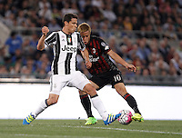 Calcio, finale Tim Cup: Milan vs Juventus. Roma, stadio Olimpico, 21 maggio 2016.<br /> Juventus' Hernanes, left, and AC Milan&rsquo;s Keisuke Honda fight for the ball during the Italian Cup final football match between AC Milan and Juventus at Rome's Olympic stadium, 21 May 2016.<br /> UPDATE IMAGES PRESS/Isabella Bonotto