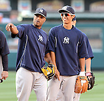 (L-R) Robinson Cano (Yankees), Gosuke Kato,<br /> JUNE 14, 2013 - MLB :<br /> Robinson Cano of the New York Yankees talks with Yankees second round draft pick Gosuke Katoh during batting practice before the Major League Baseball game against the Los Angeles Angels at Anaheim Stadium in Anaheim, California, United States. (Photo by AFLO)