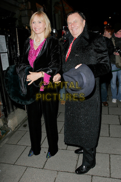 GUEST & DEAN HUMPHREYS.The Finch & Partners' Chanel Pre-BAFTA Party held at Annabel's, London, England..February 7th, 2009.full length black coat hat fedora trilby hand pink.CAP/AH.©Adam Houghton/Capital Pictures.