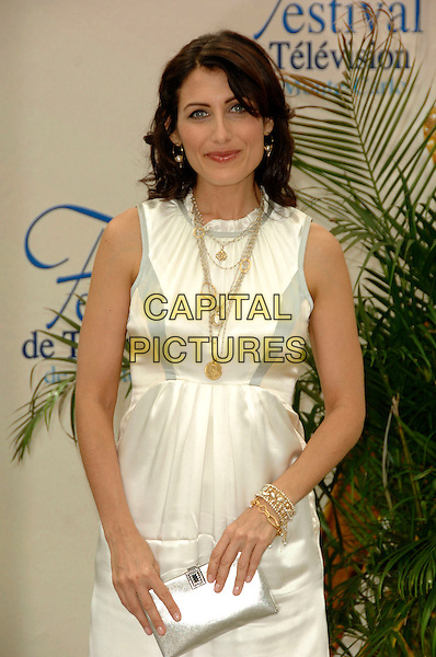 "LISA EDELSTEIN.Photocall promoting the television series ""House"" on the fourth day of the 2008 Monte Carlo Television Festival held at Grimaldi Forum, Monaco, Principality of Monaco..June 11th, 2008.half length white cream sleeveless silk satin dress silver clutch bag purse gold necklaces.CAP/TTL .© TTL/Capital Pictures"