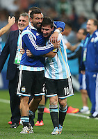 Ezequiel Lavezzi of Argentina hugs Lionel Messi as they celebrate winning the penalty shootout