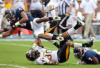 Southern Miss Golden Eagles wide receiver Ryan Balentine (80) collides with Virginia Cavaliers safety Rodney McLeod (4) and Virginia Cavaliers safety Corey Mosley (7) during the game at Scott Stadium. Virginia was defeated 30-24. (Photo/Andrew Shurtleff)