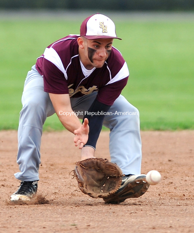 TORRINGTON,  CT, 14 MAY 2012-051412JS09- Sacred Hear's Zack Goldberg (2) fields a ground ball during their game against Torrington Monday at Fuessenich Park in Torrington. .Jim Shannon Republican-American
