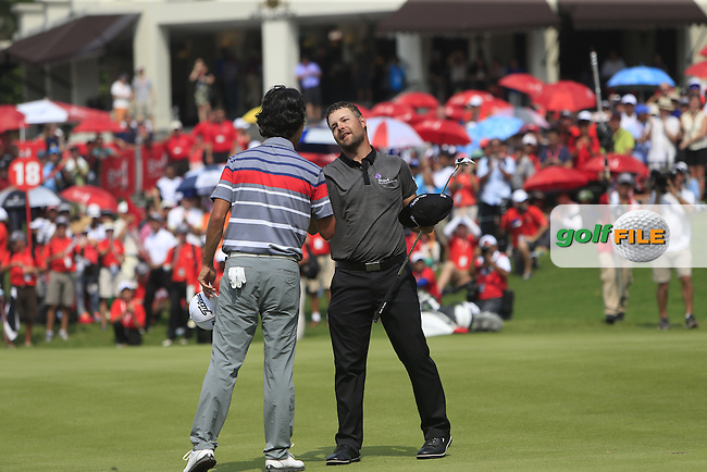 Ryan Moore (USA) on the 18th green after winning the CIMB Classic in the Kuala Lumpur Golf &amp; Country Club on Sunday 2nd November 2014. Shakes hands with Kevin Na (USA).<br /> Picture:  Thos Caffrey / www.golffile.ie