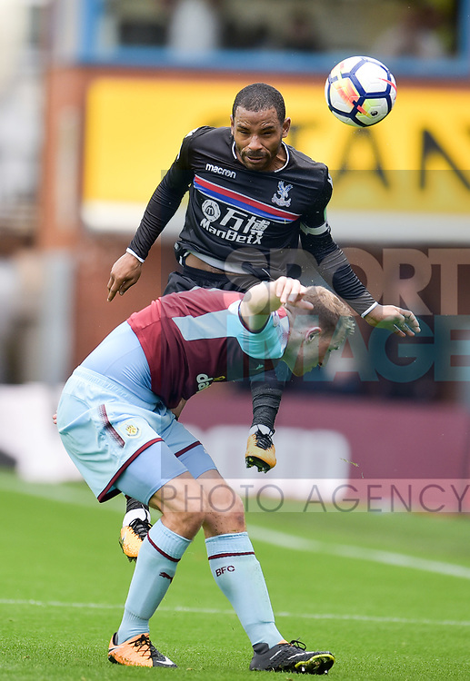 Burnley's Chris Wood and Crystal Palace's Jason Puncheon in action during the premier league match at the Turf Moor Stadium, Burnley. Picture date 10th September 2017. Picture credit should read: Paul Burrows/Sportimage