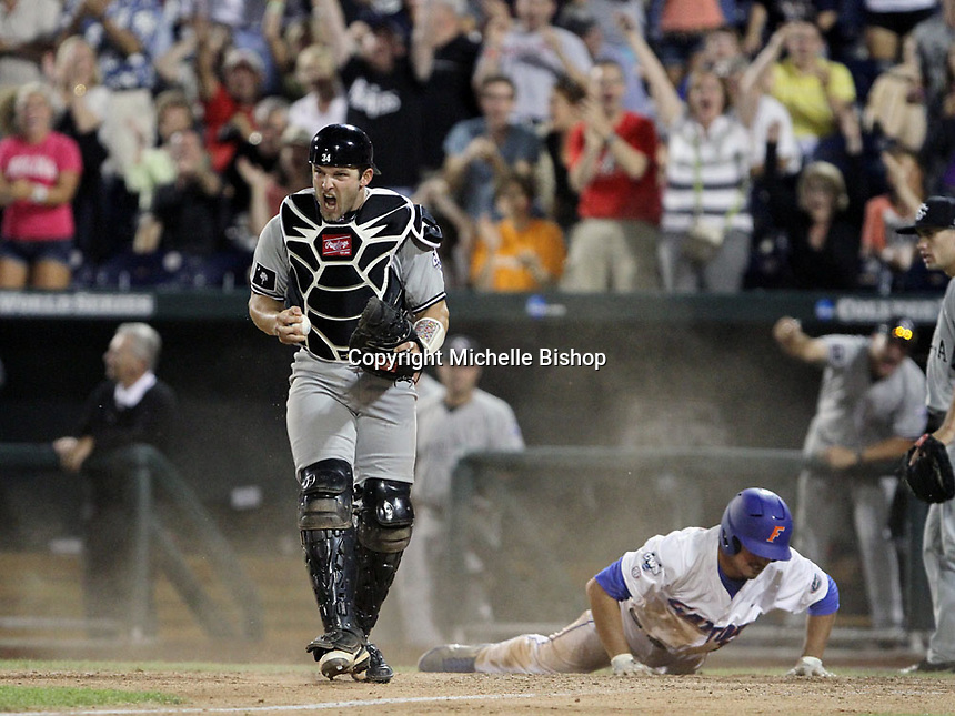 South Carolina catcher Robert Beary reacts after stopping Florida's Cody Dent from scoring the winning run in the 10th inning. South Carolina beat Florida 2-1 in Game 1 of the College World Series finals on June 27, 2011 in Omaha, Neb. (Photo by Michelle Bishop)..