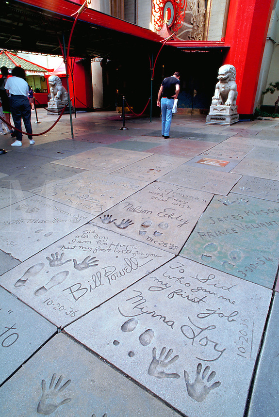 The hand prints, foot prints and autographs of celebrities written into the sidewalk in front of Mann's Chinese Theatre. Hollywood, Los Angeles, California.