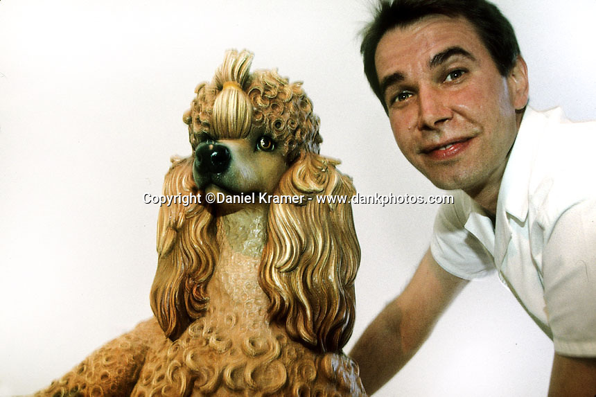 Jeff Koons poses with some of his art pieces at the Museum of Contemporary Art in Sydney, Australia in 1995.