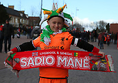 17th March 2018, Anfield, Liverpool, England; EPL Premier League football, Liverpool versus Watford;  a young Liverpool fan dressed for St Patricks Day displays his Sadio Mane scarf outside the Main Stand before the match