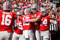 Ohio State Buckeyes tight end Nick Vannett (81) and Ohio State Buckeyes running back Ezekiel Elliott (15) celebrate Elliott's touchdown in the second quarter of the college football game between the Ohio State Buckeyes and the Maryland Terrapins at Ohio Stadium in Columbus, Saturday afternoon, October 10, 2015. As of half time the Ohio State Buckeyes led the Maryland Terrapins 21 - 14. (The Columbus Dispatch / Eamon Queeney)