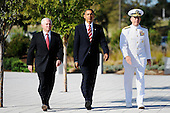 United States President Barack Obama flanked by U.S. Secretary of Defense Robert Gates and Chairman of the Joint Chiefs of Staff Michael Mullen participate in a wreath laying ceremony and moment of silence at the Pentagon Memorial to mark the 9th anniversary of the terrorist attacks, in Arlington, Virginia, September 11, 2010..Credit: Olivier Douliery - Pool via CNP