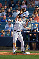 New York Yankees first baseman Chris Parmelee (24) stretches for a throw during a Spring Training game against the Detroit Tigers on March 2, 2016 at George M. Steinbrenner Field in Tampa, Florida.  New York defeated Detroit 10-9.  (Mike Janes/Four Seam Images)