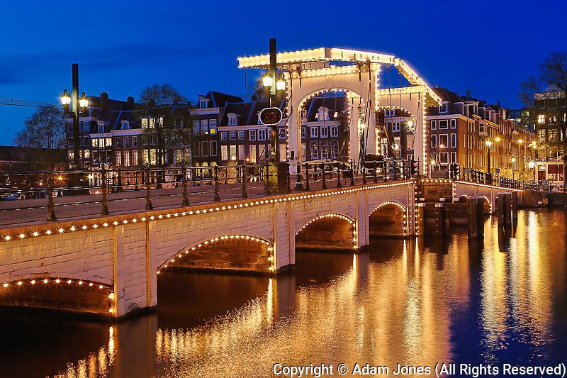 Dusk view of Magere Brug or Skinny Bridge and Amstel River; Netherlands, Holland
