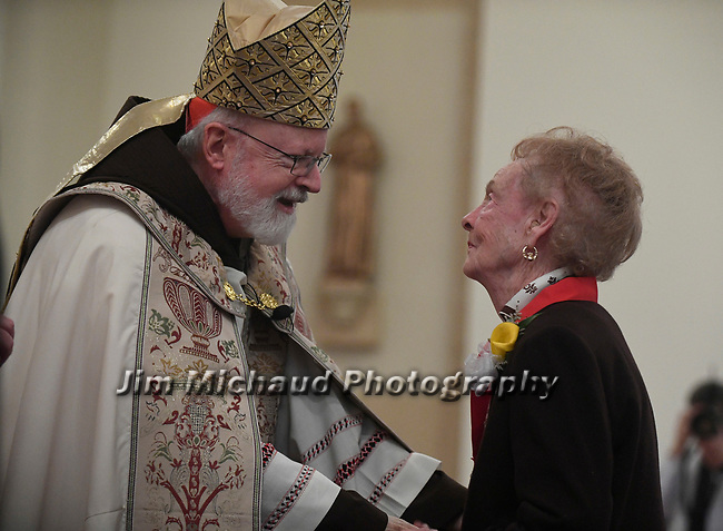 MALDEN MA NOVEMBER25: Cardinal Sean O'Malley congratulates  Dorothy Marino of Saint Mary Parish in Ayer after placing the medal on her, Marino was one of the 125 winners of the 2018 Cheverus award, Sunday, November 25, 2018, at the Immaculate Conception Church in Malden. (Herald Photo by Jim Michaud)
