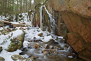 Small gorge along Cascade Brook in the Flume Gorge Scenic Area in Lincoln, New Hampshire USA during the winter months. This area is part of Franconia Notch State Park.