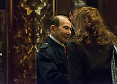 Former CEO of AIG Maurice Greenberg is seen waiting for an elevator in the lobby of Trump Tower where we converses with Trump's financial advisor Anthony Scaramucci (not seen) in New York, NY, USA on December 12, 2016. <br /> Credit: Albin Lohr-Jones / Pool via CNP