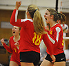 Helena Gunther #10, right, and her Sacred Heart Academy teammates react after taking a point in the second set of a CHSAA varsity girls volleyball match against host St. John the Baptist High School in West Islip on Thursday, Oct. 12, 2017. Sacred Heart won the match 3-0.