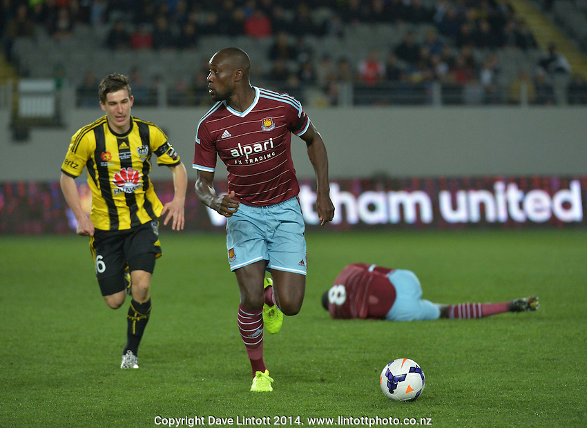 Carlton Cole chases the ball after Louis Fenton's tackle has left Cheikhou Kouyate down injured during the Football United Tour match between Wellington Phoenix and West Ham United at Eden Park, Auckland, New Zealand on Wednesday, 23 July 2014. Photo: Dave Lintott / lintottphoto.co.nz