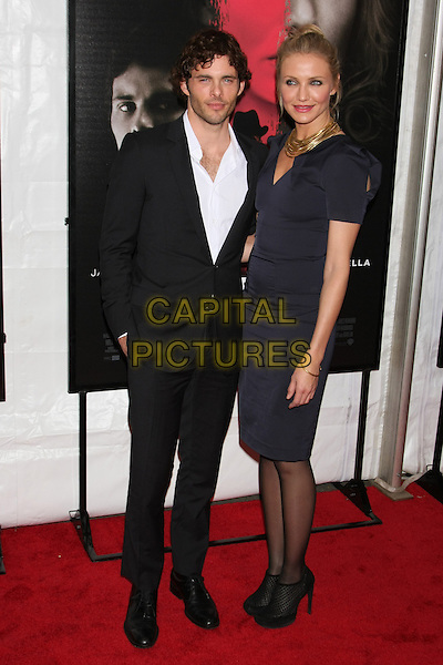 """JAMES MARSDEN & CAMERON DIAZ.""""The Box"""" New York City Premiere at the AMC Lincoln Square, New York, NY, USA. .November 4th, 2009 .full length shirt suit jacket black white  gold necklaces black blue navy shoulder pads hair up  ankle boots shoes .CAP/LNC/TOM.©TOM/LNC/Capital Pictures."""
