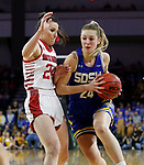 SIOUX FALLS, SD - MARCH 10: Tagyn Larson #24 of the South Dakota State Jackrabbits drives against Ciara Duffy #24 of the South Dakota Coyotes during the women's championship game at the 2020 Summit League Basketball Tournament in Sioux Falls, SD. (Photo by Richard Carlson/Inertia)