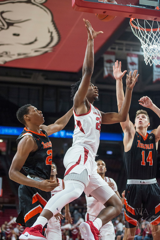 NWA Democrat-Gazette/BEN GOFF @NWABENGOFF <br /> Gabe Osabuohien of Arkansas attempts a shot as Brandon Mitchell (left) and Caleb Hodnett of Tusculum defend in the first half Friday, Oct. 26, 2018, during an exhibition game in Bud Walton Arena in Fayetteville.