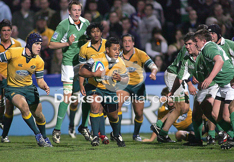 Australian winger Alfi Mafi on the attack during the Division A U19 World Championship clash at Ravenhill.