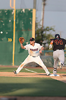 Dennis Raben #28 of the Inland Empire 66ers waits for the throw to first base as Sean Buckley #44 of the Bakersfield Blaze runs to first base during a game at San Manuel Stadium on August 21, 2014 in San Bernardino, California. Inland Empire defeated Bakersfield, 3-1. (Larry Goren/Four Seam Images)