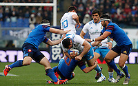Rugby, Torneo Sei Nazioni: Italia vs Francia. Roma, stadio Olimpico, 15 marzo 2015.<br /> Italy's Andrea Masi is challenged by French players during the Six Nations championship rugby match between Italy and France at Rome's Olympic stadium, 15 March 2015.<br /> UPDATE IMAGES PRESS/Riccardo De Luca