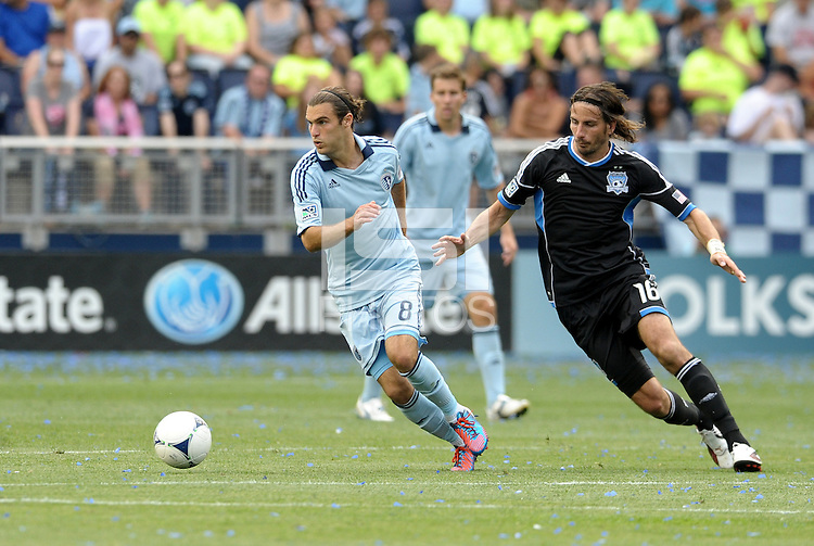 Kansas City midfielder Graham Zusi (8) goes past Alan Gordon San Jose... Sporting Kansas City defetaed San Jose Earthquakes 2-1 at LIVESTRONG Sporting Park, Kansas City, Kansas.