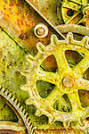 Yellow abstract of rusty wheels and gears