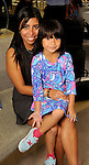 Alexzandrya Garcia with Alana Chau,5, at a Dress for Dinner event featuring shoe designer Edgardo Osorio at Saks Fifth Avenue Wednesday Oct. 28, 2015.(Dave Rossman photo)