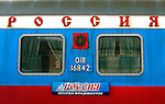 "Photo by Heathcliff Omalley..Ulan Ude - Khabarovsk  22 November 2007.A woman's face peers through the window of a "" Rossiya"" Trans Siberian railway carriage."